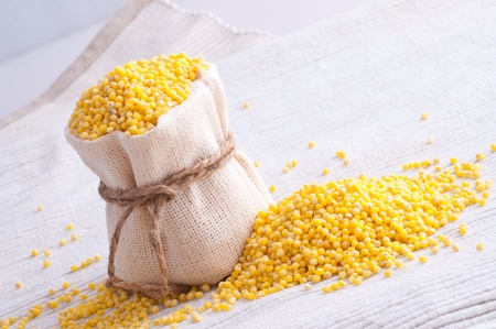 raw Millet in small sack Stock Photo