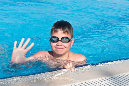 teenager swims in pool photo
