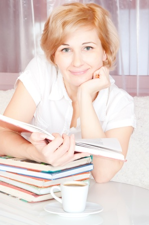young woman and stack book photo