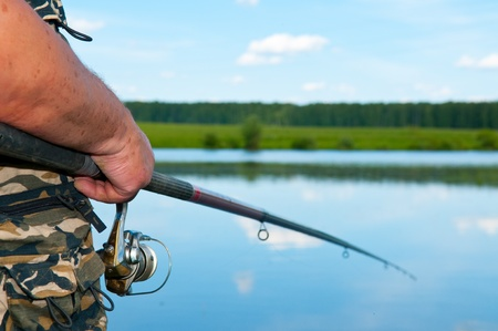 fish rod: fisherman on river Stock Photo
