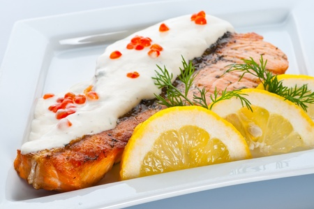 stake: Stake from a salmon with creamy sauce and caviar Stock Photo