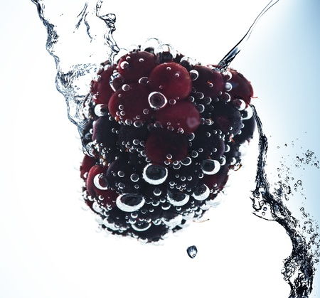 Fruit in pure water. Splash photo