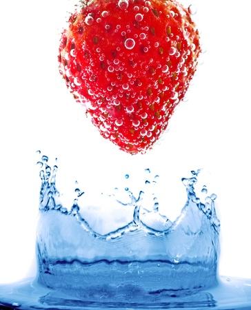 Fruit in pure water. Splash photo