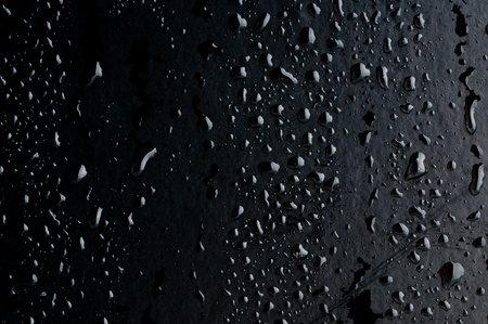 shiny black: Water drops on metal surface