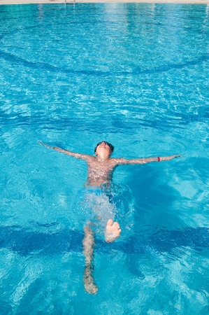 teenager swims in pool Stock Photo - 9772629