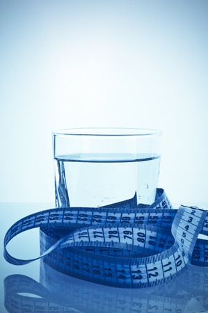 glass of clean water with a measuring Stock Photo - 9772461