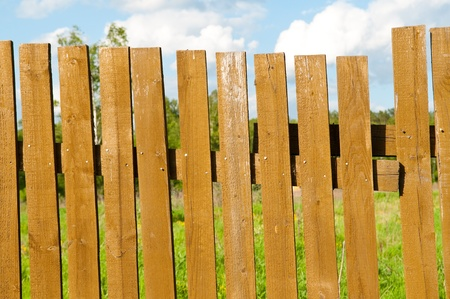 old thrown fence in wood photo