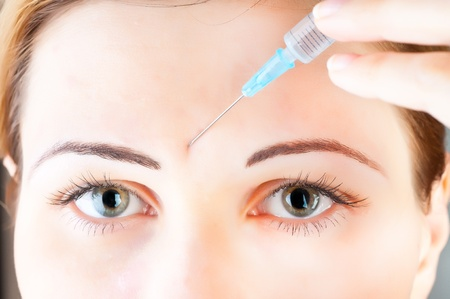 cosmetic injection of botox to the face of beautiful woman