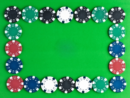 gambling counter: Counters for game in a casino on green a background