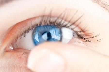 beautiful human eye and contact lens Stock Photo - 12885503