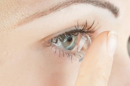 eye contact: beautiful human eye and contact lens