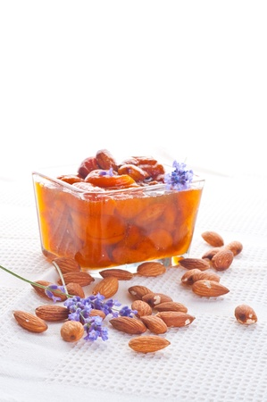 Apricot jam with almonds photo