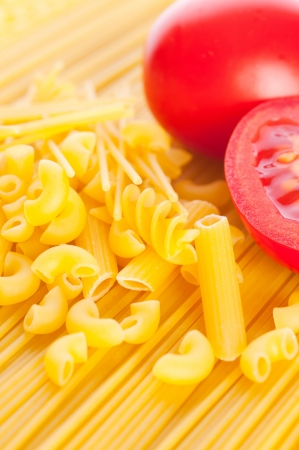 Pasta with tomatoes. isolated photo