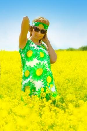 beautiful woman on rape field Stock Photo - 14454988