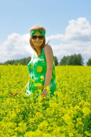 beautiful woman on rape field photo