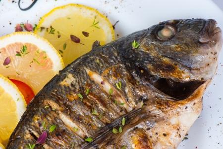 bass fishing: fish, sea bass grilled with lemon
