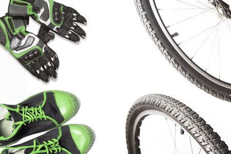 cyclist's sportswear and Bicycle wheels on a white background