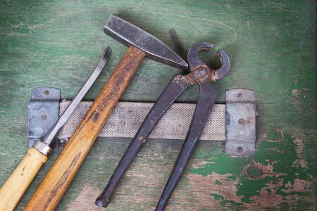 old carpentry tools on a wooden background