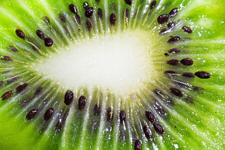 the texture of the ripe kiwi slice close-up background