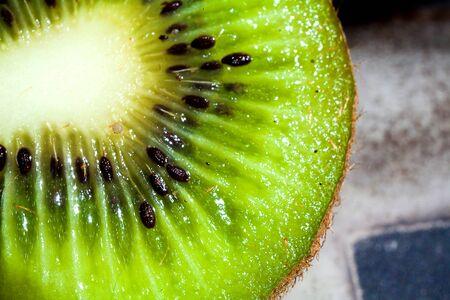 macro photography a close up of a ripe kiwi