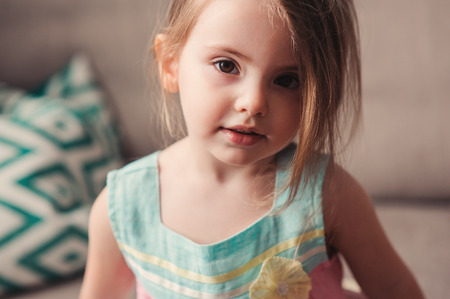 cute toddler girl relaxing at home