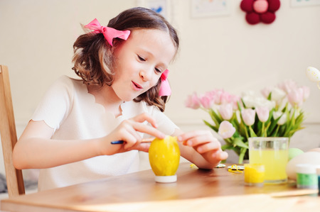 easter craft with kids - painting eggs at home. Seasonal spring decorations