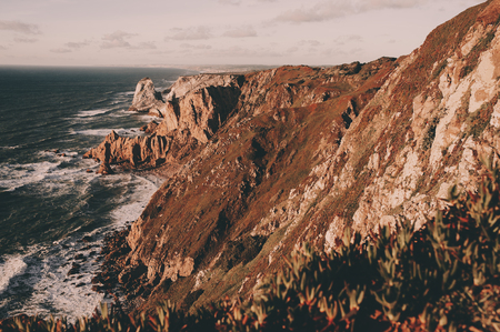 Exploring Portugal. Cabo da Roca ocean and mountains view, authentic lifestyle capture, wanderlust concept.