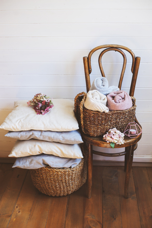 cozy interior details, scandinavian mininalistic lifestyle. Organizing clothes in wicker backets, seasonal wardrobe and house cleaning, ideas for winter season. Stok Fotoğraf