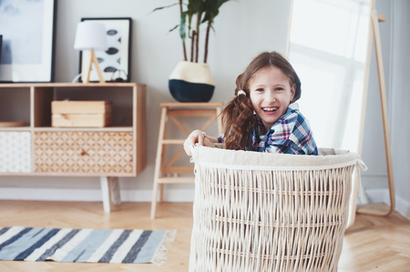happy kid girl posing in modern new interior. Buying new home, moving to new apartment concept Stok Fotoğraf