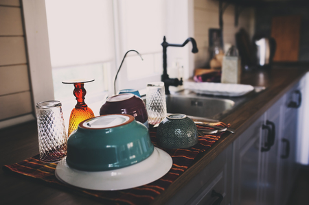clean dishes in modern kitchen. Washing plates, glasses and tableware, housework concept