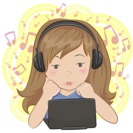 Little girl at the laptop listening to the music with earphones.