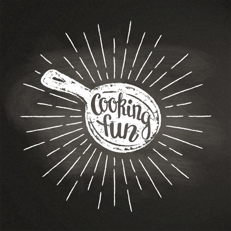 Chalk silhoutte of a pan with sun rays and lettering - Cooking fun - on blackboard. Good for cooking bades, menu design or posters.