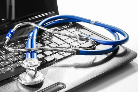 healthcare and technology: stenoskop on laptop repair service maintenance warranty diagnostics Stock Photo