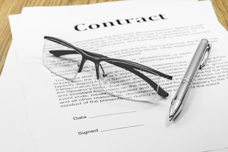business case: contract business papers pen glasses business case