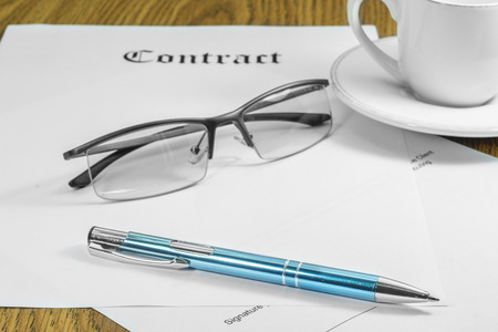 paper and pen: contract business papers pen glasses cup of coffee