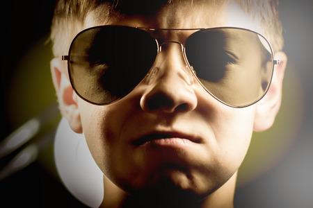 pert: boy in sunglasses serious look pert portrait