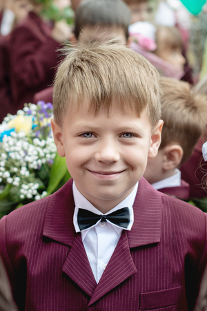 boy dressed as a schoolboy smiling cheerful portrait Stock Photo