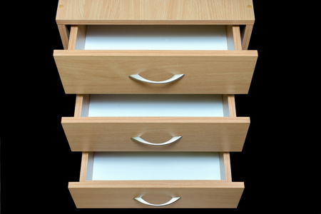 imagery: three open drawers with metal handles wood facade isolate