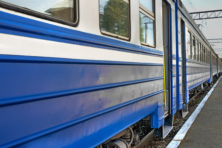 linear perspective: blue train cars are at the station, linear perspective
