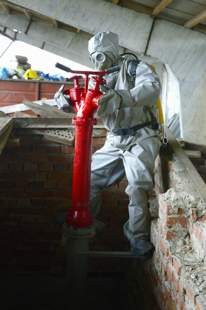 eliminate: Worker chemical protection suit holds a special operation to eliminate