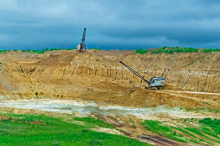 agricultural engineering: open-cast, borrow pit, bulldozer, gopher, cave Stock Photo