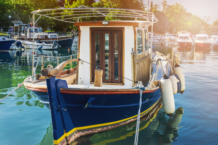 sveti: wooden boat at the pier in Budva summer vacation