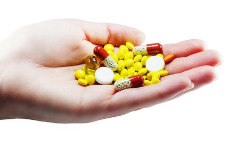 pastillas: Palma femenina de color y pastillas de color blanco aislado