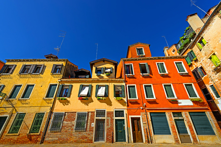 linear perspective: Venice, colorful houses, summer sunny day, blue sky,linear perspective