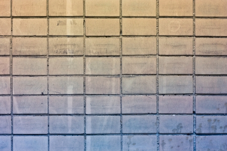 crannied: Texture of tiled old wall  Gradiend from yellow to blue Stock Photo