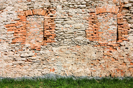 Brick wall with Bricked up windows. Background Imagens