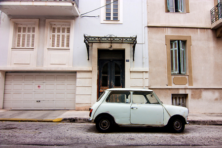 White old car on the street in the Athens
