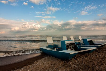 Two catamarans at coastline of Azov sea in Ukraine