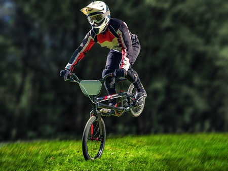 stunt: A stunt bicyclist doing high jumps on a bicycle