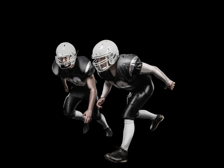 Professional american football players on the black background